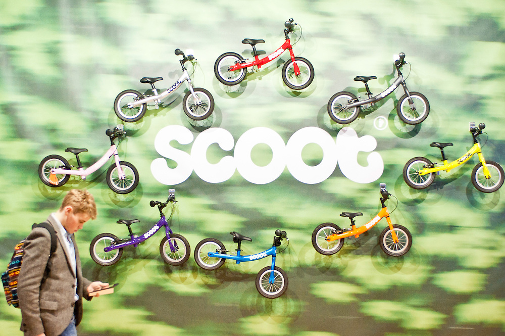 London, UK - 17 January 2013:  a visitor passes by the Scoot stand during the London Bike show 2013 at the Excel.