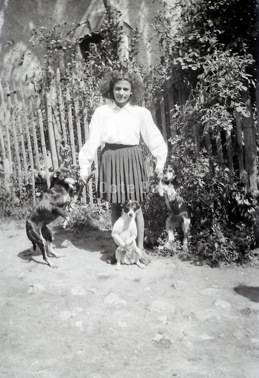 girl posing with dogs