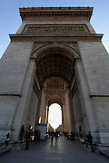 View of Arc de Triomphe in Paris. It sits in the middle of Place Charles de Gaulle - a crazy intersection with 12 roads radiating from it.