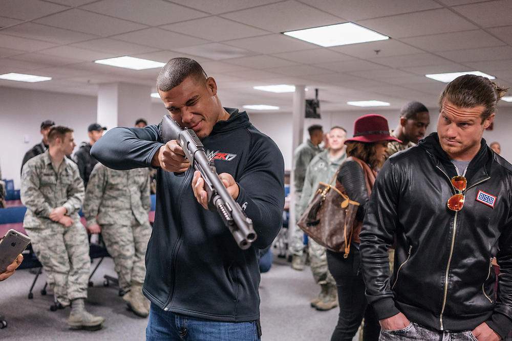 Prince George's County, MD - December  13, 2016:  WWE stars Joason Jordan and Dolph Ziggler handle military weapons during Tribute to the Troops Day at the Joint Base Andrews in Prince George's County, Maryland.  WWE Superstars will spend time with members of all five branches of the military.  WWE began Tribute to the Troops in 2003 as a way to honor our servicemen and women and their families.   (Greg Kahn for ESPN)