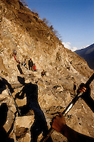 "Kalikot, 08 March 2005.  At few kilometres from Manma, a road is under construction. """"The road is for us, the RNA and the Police Force. Once completed, it will be easier to get to the Maoist areas"" a Police inspector from Manma says. In most of the Kalikot's area, walking is the only method of transport. Donkeys are also used for moving cargo."