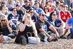 © Licensed to London News Pictures. 20/09/2015. Brighton, UK. people are watching the Rugby world cup match between USA and Samoa on Brighton Beach. Today September 20th 2015. Photo credit : Hugo Michiels/LNP