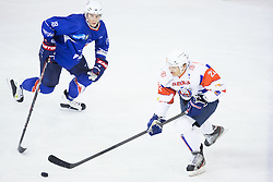 Marcel Rodman of Slovenia and Yohann Auvitu of France during ice-hockey match between Slovenia and France in Slovenia Euro ice hockey challenge, on November 9, 2012 at Hala Tivoli, Ljubljana, Slovenia. (Photo By Matic Klansek Velej / Sportida)