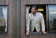 Signs of recovery in Miyagi Prefecture, Japan on 01 Dec., 2011. .Photographer: Robert GilhoolyNobuo Hariu, CEO and co-founder of Butai Farm, stands inside the offices of his company in Sendai, Japan on December 01, 2011.  The company was established as Butai Farm in 2003 with the idea of developing a company that would work on the whole farming process -- from production to processing, distribution, and sales. The March 11 tsunami flooded about 60% of the company's 40-hectare farmland. While working toward the reconstruction of the land, they have also introduced a three-tier radiation testing system in an attempt to recover consumer confidence..Photographer: Robert Gilhooly