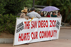 Protestors outside of San Diego Zoo with sign, San Diego, California, United States of America
