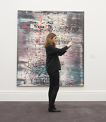 Sotheby's, London, January 28th 2016. A woman admire's Abstraktes Bild, painted in 1990 by Gerhard Richter, who is considered to be the world's greatest living painter. Expected to fetch between £14 - 20 million, it is to be auctioned by Sotheby's in London as part of their sale of Impressionist, Modern, Surrealist and Contemporary art. ///FOR LICENCING CONTACT: paul@pauldaveycreative.co.uk TEL:+44 (0) 7966 016 296 or +44 (0) 20 8969 6875. ©2015 Paul R Davey. All rights reserved.