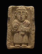 Stele with relief of a man wearing a long chasuble, possibly a Parthian priest from Western Iran, 2nd-3rd century AD, 1 of 15 found in 1991 buried in a garden in Qal'at al Bahrain, displayed in the Qal'at Al-Bahrain Site Museum, near Manama in Bahrain. These stelae may have been buried during the islamic period, or placed in graves during the Tylos phase, but their purpose remains unclear. The museum was opened in 2008, displaying artefacts of the history and archaeology of the Qal'at al-Bahrain, or Bahrain Fort or Portuguese Fort, built 6th century AD, once the capital of the Dilmun Civilisation. Qal'at al-Bahrain is listed as a UNESCO World Heritage Site. Picture by Manuel Cohen