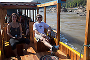 Boat trip up to the Thousand Buddha Caves on the Mekong River, Luang Prabang, Laos.