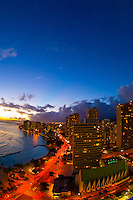 Twilight overview of the highrises of Waikiki from the Waikiki Beach Marriott Resort, Honolulu, Oahu, Hawaii, USA