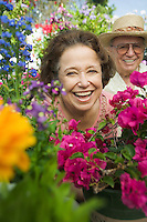 Senior Couple Surrounded by Flowers