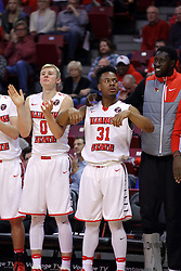 """26 November 2016:  Bench celebration includes Isaac Gassman(0), Javaka Thompson(31), and Daouda """"David"""" Ndiaye (4) during an NCAA  mens basketball game between the IUPUI Jaguars the Illinois State Redbirds in a non-conference game at Redbird Arena, Normal IL"""