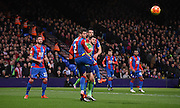Joel Ward heads clear the danger during the Barclays Premier League match between Crystal Palace and Southampton at Selhurst Park, London, England on 12 December 2015. Photo by Michael Hulf.