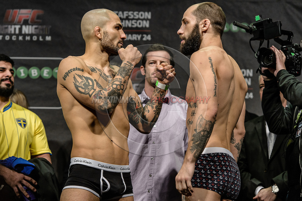 "STOCKHOLM, SWEDEN, JANUARY 23, 2015: Akira Corassani and Sam Sicilia face off during the official weigh in for ""UFC on Fox 14: Gustafsson vs. Johnson"" inside Hovet Arena in Stockholm, Sweden"