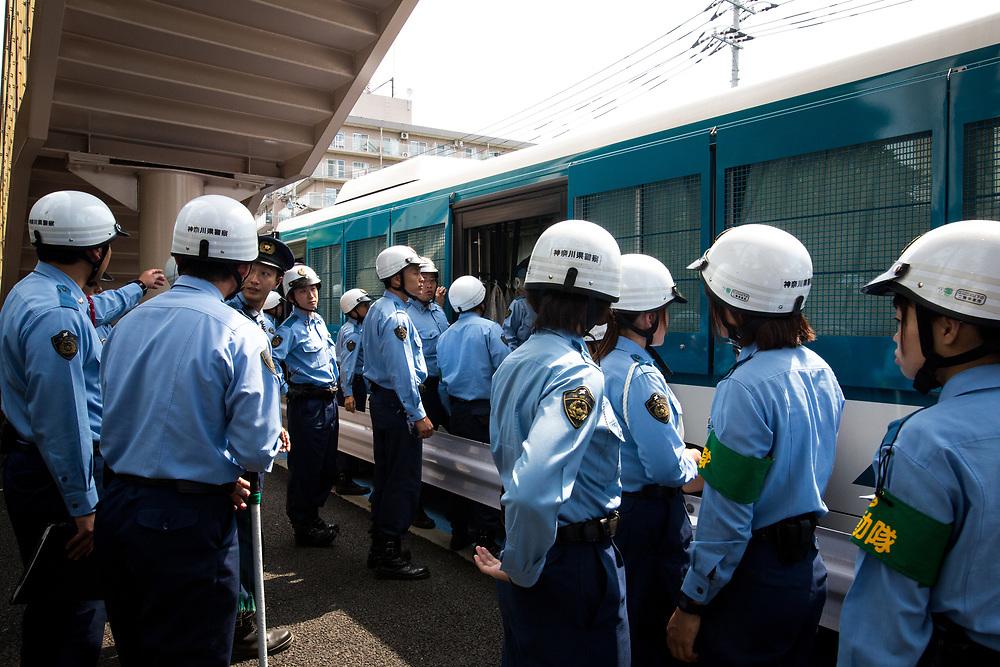 "KAWASAKI, JAPAN - JULY 16: Japanese police are seen during a counter-protest action against ""hate speech demonstration"" in Nakahara, Kawasaki City, Kanagawa prefecture, Japan on July 16, 2017. (Photo by Richard Atrero de Guzman/NUR Photo)"