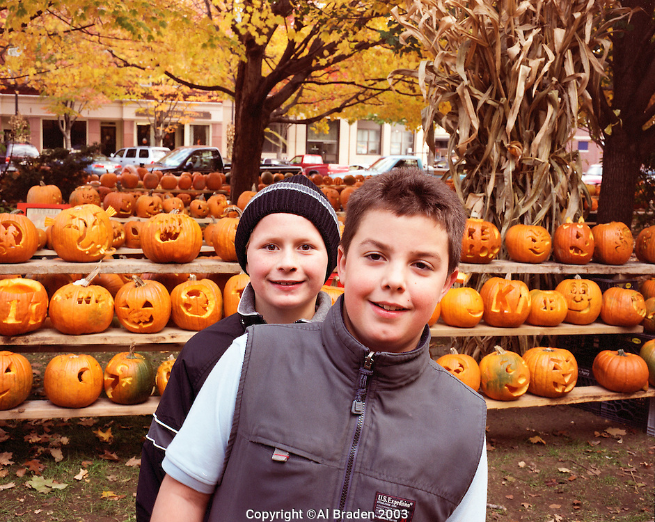 Two Boys in front of Jack o Lanterns at Central Square, Keene Pumpkin Festival