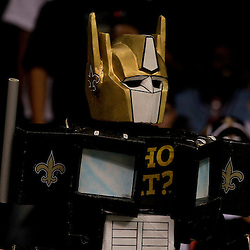 2009 September 13: A New Orleans Saints fan dressed as a black and gold Optimus Prime from transformers known as Optimus Saint cheers from the stands during a 45-27 win by the New Orleans Saints over the Detroit Lions at the Louisiana Superdome in New Orleans, Louisiana.