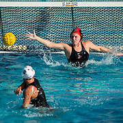 11 February 2018: The San Diego State  women's water polo team competes in day two of the Triton Invitation on the campus of UCSD.]San Diego State Aztecs goalkeeper Maura Cantoni (1) attempts to block a penalty shot from CSUN Matadors Katelyn Fairchild (5) in the second quarter. The Aztecs took on the #23 CSUN Matadors Sunday morning and came away with a 8-5 win.<br /> More game action at www.sdsuaztecphotos.com