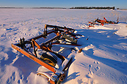 Farm machinery in winter field of snow<br />Anola<br />Manitoba<br />Canada