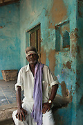 Man seated on the thinnai of his home in Nagapattinam.