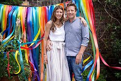 """Jamie Oliver releases a photo on Instagram with the following caption: """"A Massive belated congrats to my lovely wife @joolsoliver for celebrating 5 years of designing @littlebirdbyjools great job babe I'm so proud of you time to do some stuff for the dads now \ud83d\ude1clove jumx x x"""". Photo Credit: Instagram *** No USA Distribution *** For Editorial Use Only *** Not to be Published in Books or Photo Books ***  Please note: Fees charged by the agency are for the agency's services only, and do not, nor are they intended to, convey to the user any ownership of Copyright or License in the material. The agency does not claim any ownership including but not limited to Copyright or License in the attached material. By publishing this material you expressly agree to indemnify and to hold the agency and its directors, shareholders and employees harmless from any loss, claims, damages, demands, expenses (including legal fees), or any causes of action or allegation against the agency arising out of or connected in any way with publication of the material."""