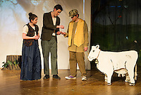 """Alana Persson (the Baker's Wife) and Michael O'Brien (the Baker) give Bryson Haddock (Jack) some beans for his cow Whitey during dress rehearsal for """"Into The Woods"""" at Laconia High School Wednesday afternoon.  (Karen Bobotas/for the Laconia Daily Sun)"""