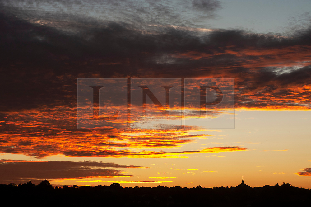 ©Licensed to London News Pictures 11/09/2019.<br /> Orpington ,UK. A cloudy orange sunset over South East London this evening as temperatures are set to soar at the weekend. Photo credit: Grant Falvey/LNP