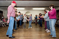 Devin Schwarz and Mollie Durand sashay down the Virginia Reel line during the Spring Fling Hoedown dance at the Wicwas Grange Hall Saturday evening.  (Karen Bobotas/for the Laconia Daily Sun)