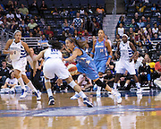 [3 picture sequence]The Washington Mystic's Lindsey Harding and the Atlanta Dream's Shalee Lehning collide while going after a loose ball. In the hit and subsequent fall to the the floor, Lehning injured her left shoulder and left the game.