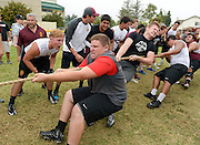 Cory Price of Simi Valley receives encouragement from teammates during a tug-of-war with Pacifica during the Ventura County Hogs Tournament at Moorpark High School on June 13, 2015.
