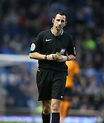 Referee Christopher Kavanagh produces a yellow card during the Sky Bet Championship match between Brighton and Hove Albion and Wolverhampton Wanderers at the American Express Community Stadium, Brighton and Hove, England on 1 January 2016.