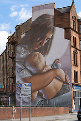Large mural on wall of tenement building in Glasgow, Scotland, UK