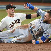 Kansas City Royals Alex Gordon steals second base despite the effort by San Francisco Giants second baseman Joe Panik during the third inning in Game 4 of the World Series on Saturday, October 25, 2014 at AT&T Park in San Francisco, Calif.