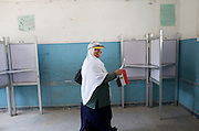An Egyptian woman  with a national flag at vote at a polling station in the El Mokattam neighborhood of  Cairo , Egypt May 23, 2012. Egyptians head to the polling stations throughout Egypt  Wednesday for an historic opportunity in which they will for the first time to pick their president in a wide open election that pits Islamists against men who served under deposed leader Hosni Mubarak.(Photo by Heidi Levine/Sipa Press).