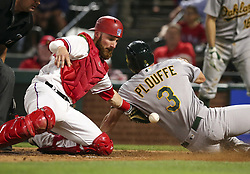 May 12, 2017 - Arlington, TX, USA - Texas Rangers catcher Jonathan Lucroy (25) doesn't have the ball as he tries to make the tag at home on Oakland Athletics Trevor Plouffe (3), who scores in the seventh inning on Friday, May 12, 2017 at Globe Life Park in Arlington, Texas. (Credit Image: © Richard W. Rodriguez/TNS via ZUMA Wire)