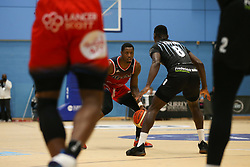 Fred Thomas of Bristol Flyers on the ball - Photo mandatory by-line: Arron Gent/JMP - 07/12/2019 - BASKETBALL - Surrey Sports Park - Guildford, England - Surrey Scorchers v Bristol Flyers - British Basketball League Championship
