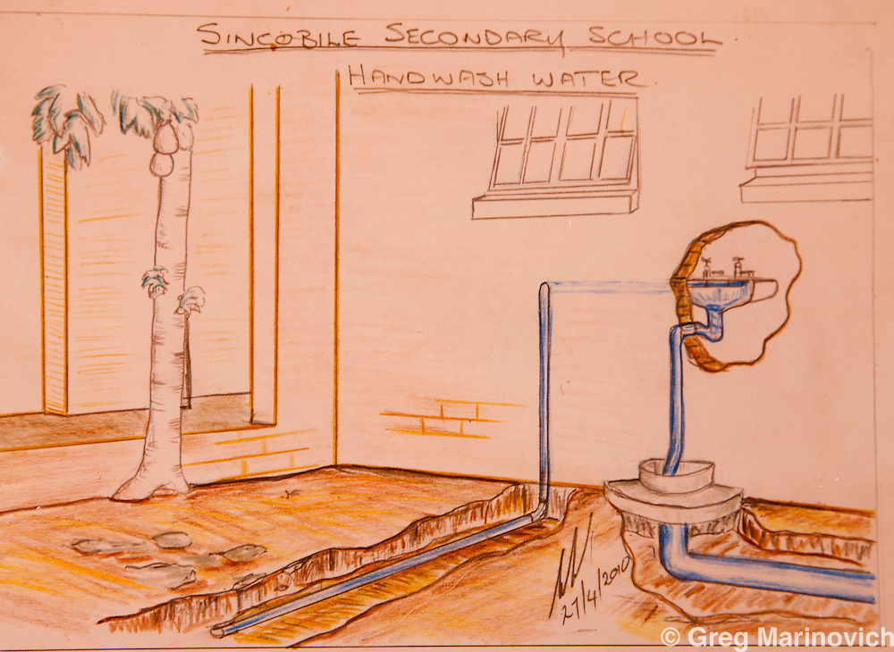 Phakama Trust, Nkomati district, Mpumalanga province, South Africa April 13, 2011: A drawing of the technology used at the Sincobile Secondary School. The combination of urine diversion toilet system and Permaculture garden at Sincobile High School stands out to be the greatest achievement of the Inkomati project. The intention of this pilot project is that the local municipality and the Mpumalanga Provincial Government (and other responsible parties) will be able to duplicate the project in other schools and the community.  Others in these images are eco-builder Enoch Hlatswayo; Sipho Masango, 16; Rose Zitha, Gloria Gxayiya; and Thandi Sibya (last three in veggie gdn) Photo Greg Marinovich.