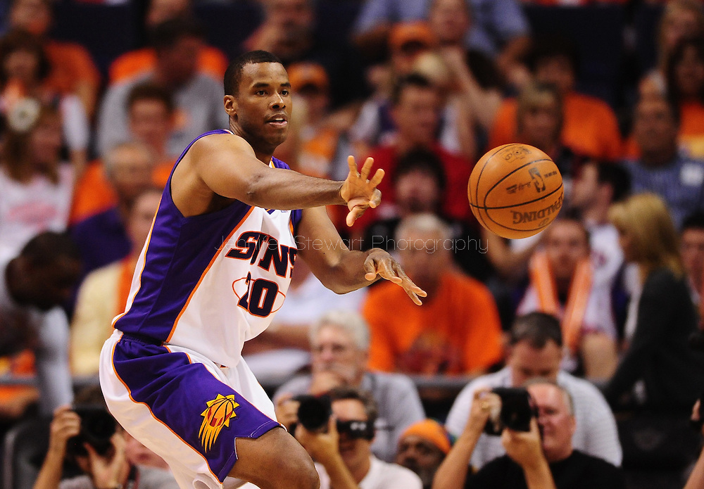 Apr 26, 2010; Phoenix, AZ, USA; Phoenix Suns center Jarron Collins (20) makes a pass during the third quarter in game five in the first round of the 2010 NBA playoffs at the US Airways Arena.  The Suns defeated the Trail Blazers 107-88.  Mandatory Credit: Jennifer Stewart-US PRESSWIRE