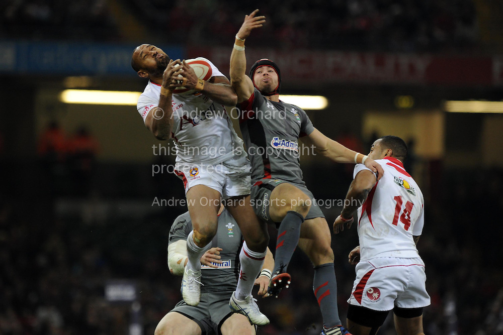 Leigh Halfpenny of Wales ® jumps for the ball with Tonga's Vunga Lilo.Dove Men series, autumn international rugby match, Wales v Tonga at the Millennium Stadium in Cardiff, South Wales on Friday 22nd November 2013. pic by Andrew Orchard, Andrew Orchard sports photography,