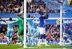 Everton's Romelu Lukaku grabs the net in frustration - Mandatory byline: Matt McNulty/JMP - 07966386802 - 23/08/2015 - FOOTBALL - Goodison Park -Everton,England - Everton v Manchester City - Barclays Premier League