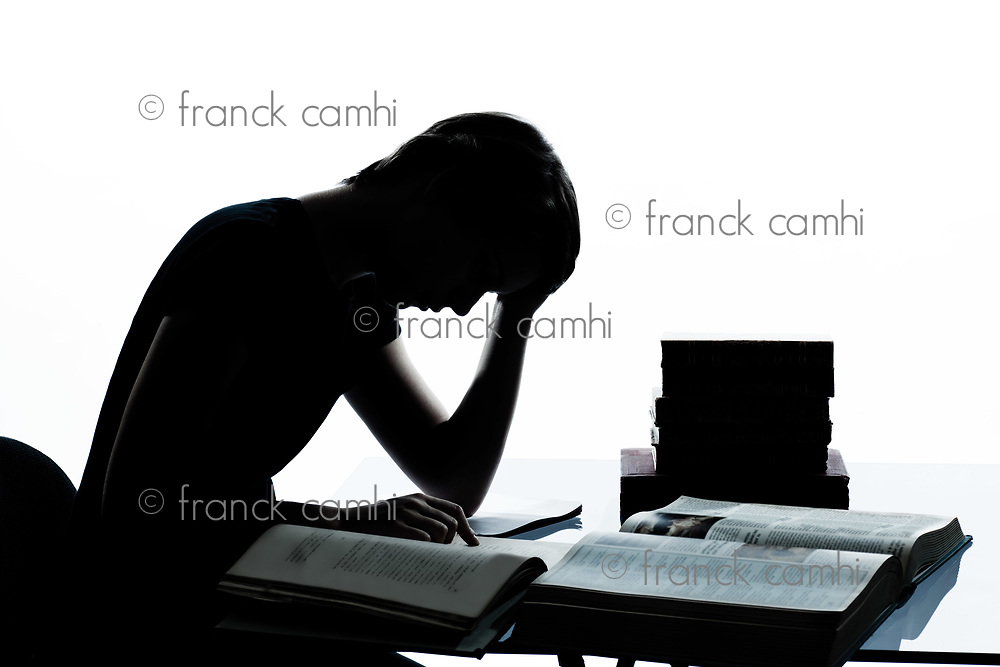 one caucasian young teenager silhouette boy girl studying tired reading books in studio cut out isolated on white background