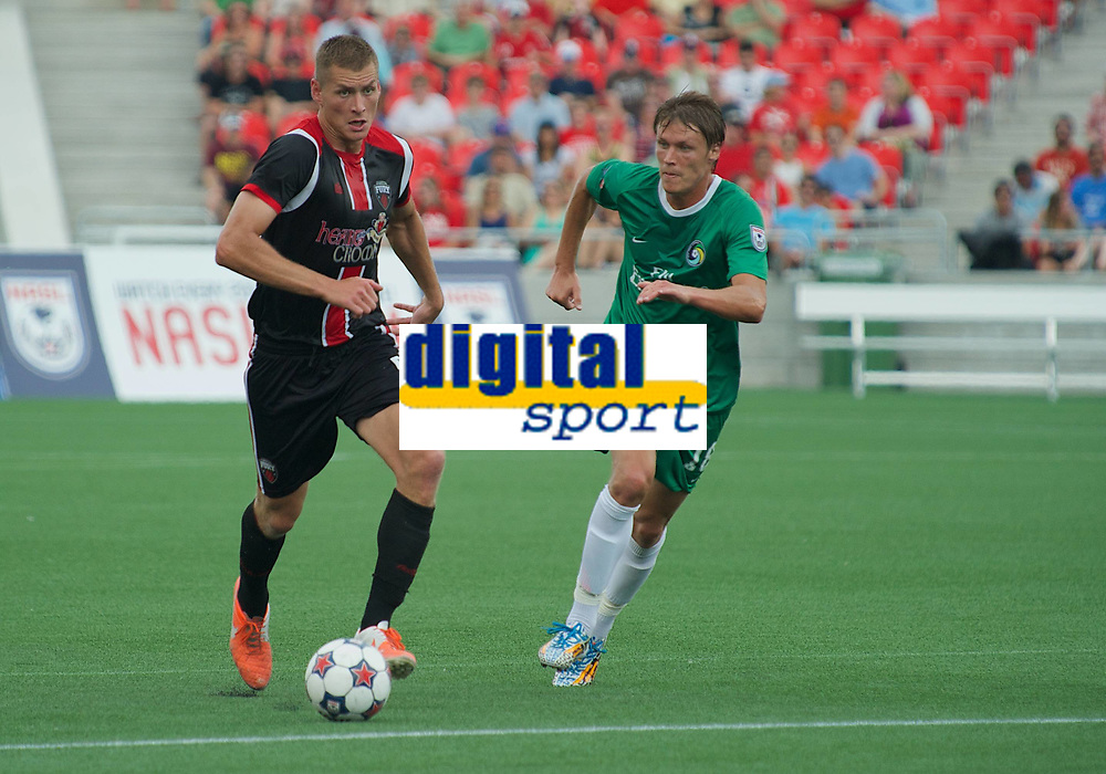 Fotball<br /> USA<br /> Foto: imago/Digitalsport<br /> NORWAY ONLY<br /> <br /> July 20, 2014: Omar Jarun (Left 5) brings the ball forward despite the attention of Mads Stokkelien (18) during the Ottawa Fury game versus the New York Cosmos at TD Place Stadium in Ottawa, ON. Canada. The Cosmos won 1-0 in front of a new record NASL crowd of 14, 595.