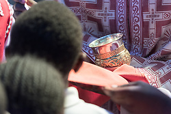 16 October 2016, Nairobi, Kenya: Sunday service in the (Greek Orthodox) Saint Pathenios Orthodox Church, an autonomous congregation in the Waithaka neighbourhood in Nairobi, Kenya. Service is given in the local vernacular Kikuyu, with elements of English. The church mixes traditional orthodox rituals with African dance and music, as well as Pentecostal influences in their services. The church allows both women and men to be preachers, and efforts are also underway towards letting women become ordained. Sunday service comes in three blocks: morning glory, holy communion, and a session of preaching, before women, men, and youth, respectively, gather for safe-space fellowship meetings shortly after the service.