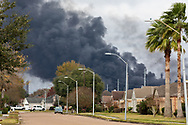 Plume from the Texas Petroleum Chemical  plant, on fire the day after multiple explosions rocked the plant,  near homes that are 1/2 mile from the plant. Though authorities issued a mandatory evacation for those living in a four mile radious of the plant, many remained at home.  Regualtors warned that its air monitoring indicates no human health concerns, though the incident is causing the release of chemicals called volatile organic compounds (VOCs) and that elevated levels of VOCs from this facility are odorous. Short-term exposure to high concentrations of VOCs can cause eye, nose, and throat irritation, shortness of breath, headaches, and nausea.