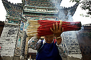 A woman prays in a temple in a village outside Dali, Yunnan province, southwestern China.