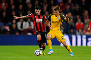 Adam Smith (15) of AFC Bournemouth is tackled by Solly March (20) of Brighton and Hove Albion during the Premier League match between Bournemouth and Brighton and Hove Albion at the Vitality Stadium, Bournemouth, England on 15 September 2017. Photo by Graham Hunt.
