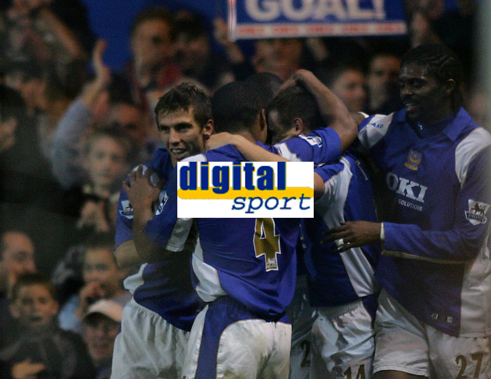Photo: Lee Earle.<br /> Portsmouth v Aston Villa. The Barclays Premiership. 02/12/2006. Portsmouth's Matthew Taylor (2ndR) is congratulated after scoring their second from the penalty spot.