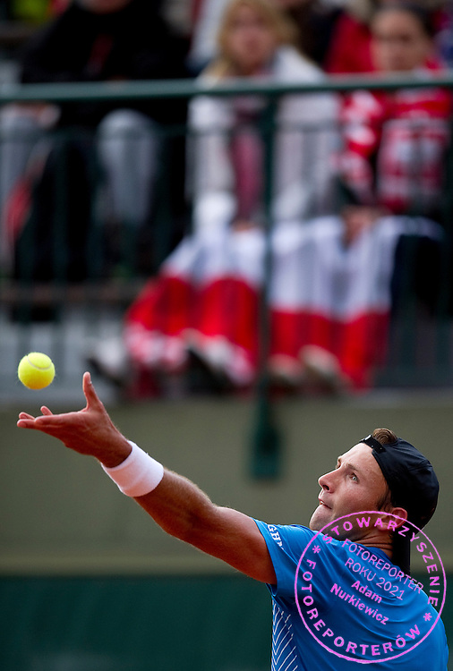 Lukasz Kubot of Poland competes in men's singles while Day Third during The French Open 2013 at Roland Garros Tennis Club in Paris, France...France, Paris, May 28, 2013..Picture also available in RAW (NEF) or TIFF format on special request...For editorial use only. Any commercial or promotional use requires permission...Mandatory credit:.Photo by © Adam Nurkiewicz / Mediasport