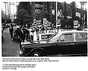 Demonstrating hotel workers outside Beverley Hills Hotel. Beverley Hills Hotel re-Opening party. Los Angeles 1995. Film 95273/6 <br />© Copyright Photograph by Dafydd Jones<br />66 Stockwell Park Rd. London SW9 0DA<br />Tel 0171 733 0108