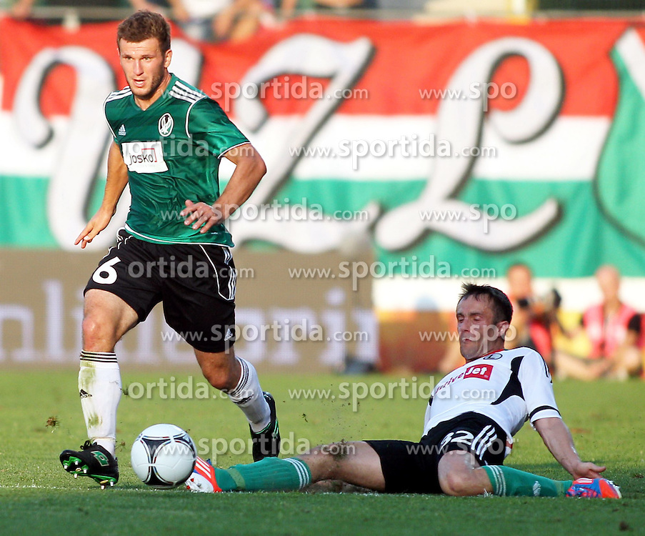 02.08.2012, Keine Sorgen Arena, Ried, AUT, UEFA EL, Hinspiel, SV Josko Ried (AUT) vs Legia Warschau (POL), im Bild Andreas Schicker, (SV Josko Ried, #6) und Miroslav Radovic, (Legia Warschau, #32) // during the UEFA Europa League 1st Leg Match between SV Josko Ried (AUT) and Legia Warsaw (POL) at the Keine Sorgen Arena, Ried, Austria on 2012/08/02. EXPA Pictures © 2012, PhotoCredit: EXPA/ Roland Hackl