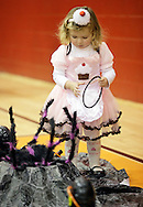 Middletown, New York - A girl wearing a costume plays a game in the gymnasium during the Middletown YMCA Family Fall Festival on Oct. 29, 2011.